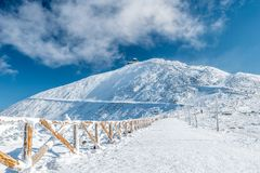 Fenced hiking path to Snezka mountain on a sunny day in winter, Giant mountains Krkonose, Czech republic stock image