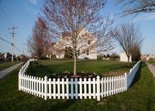 Fenced house Stock Photo