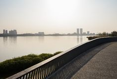 Fenced lakeside path in sunny winter afternoon,Tianfu New Area. Fenced lakeside path in sunny winter afternoon at Tianfu New Area,Chengdu,China stock images