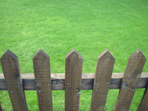 Fenced lawn. Wooden fenced fresh green lawn Royalty Free Stock Photo