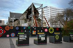 Fenced off debris of partially collapsed historic Christchurch Cathedral supported by steel frame seismic bracing in New Zealand stock photos