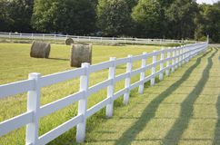 Fenced Pastures And Rolled Hay Bales Royalty Free Stock Photo