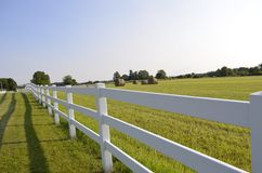Fenced pastures and rolled hay bales Stock Image