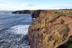 The fenced path along the cliff edge Royalty Free Stock Images