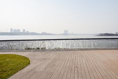 Fenced and planked lakeside on slope in sunny winter afternoon. Fenced and planked lake shore on the slope in sunny winter afternoon,Tianfu New Area,Chengdu royalty free stock images
