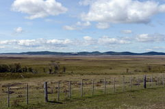 Fenced private plot of land in Tierra del Fuego. Stock Image