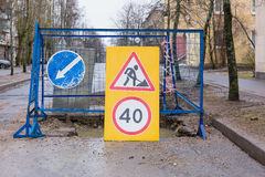 Fenced repair work on the road Stock Images