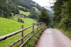Fenced road Royalty Free Stock Image