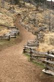 Fenced trail. Fences along a trail up a hill Royalty Free Stock Photo