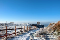 Fenced walk to ballybunion castle in winter snow. Snow covered view of atlantic ocean and castle in ballybunion on a frosty snow covered winters day Royalty Free Stock Photos