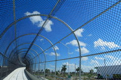 Fenced Walkway on Blue Sky. Shot in daytime Royalty Free Stock Photo