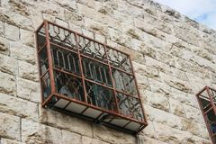 Fenced window in the occupied city of Hebron in the palestinian. Fenced window of an Israeli Jewish settlers house in Hebron for protection of stones thrown Royalty Free Stock Photos