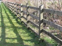 Fenceline Shadows Stock Images