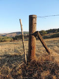 Fencepost at the farm Stock Photography