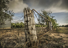 Fencepost on a rural farm in outback Australia Stock Photo