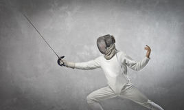 Fencer. Portrait of a young fencer on guard Royalty Free Stock Images
