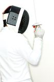 Fencer 5. Fencer in position in high key Royalty Free Stock Photo