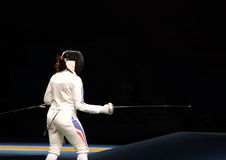 Fencer. A fencer in attack position with black background stock images