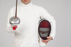 Fencer athlete. With sword and mask over grey background royalty free stock photo