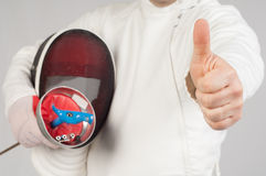 Fencer athlete. With sword and mask making ok sign over grey background royalty free stock photo