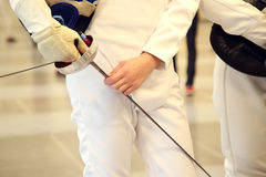 Fencer with fencing mask and rapier Stock Image