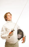 Fencer looking on rapier Stock Images