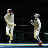 Fencer of United States team L competes against team Egypt fencer in the Men`s team foil of the Rio 2016 Olympic Games. RIO DE JANEIRO, BRAZIL - AUGUST 12, 2016 Stock Photos