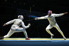 Fencer of United States team R competes against team Egypt fencer in the Men`s team foil of the Rio 2016 Olympic Games. RIO DE JANEIRO, BRAZIL - AUGUST 12, 2016 Stock Photo