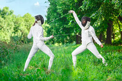 Fencer women fighting over beautiful nature Royalty Free Stock Photography