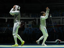Fencers Alexander Massialas of USA (L) and Alexey Cheremisinov of Russia compete in the Men's team foil Stock Photo