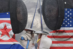 Fencers us and north corea Royalty Free Stock Photography