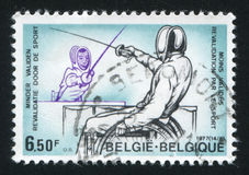 Fencers in wheelchairs. RUSSIA KALININGRAD, 20 OCTOBER 2015: stamp printed by Belgium, shows Fencers in wheelchairs, circa 1977 Stock Photo