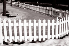 Fences. Fence next to a road in black and white Stock Photo