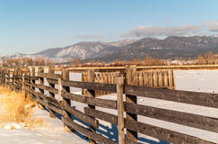Fences, Fields, and Mountains Royalty Free Stock Photos