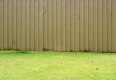 Fences and green grass Royalty Free Stock Images