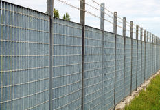 Fences. Pinned anti-climb fence in perspective stock photography