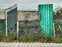Fences. A variety of fences using steel, corrugated & open mesh Royalty Free Stock Photo