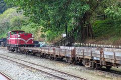 Fenchihu,taiwan-October 15,2018:Red train stop in fenchihu train station at alishan mountain,taiwan. Fenchihu,taiwan-October 15,2018:Red train stop in fenchihu royalty free stock photo
