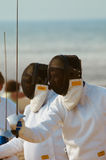 Fencing. Men outdoors in full fencing gear Stock Photos