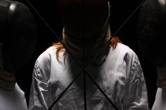 Fencing. Men and women with swords Royalty Free Stock Photography
