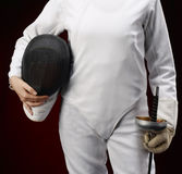 Fencing. Woman with mask and sword royalty free stock photography