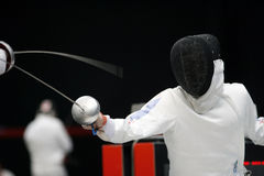Fencing. Fight at a fencing competition Stock Images