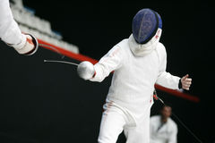 Fencing. Fight at a fencing competition stock photos