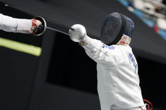 Fencing. Fight at a fencing competition royalty free stock photo