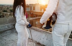 Fencing athletes people practicing outdoor on rooftop. Two fencing athletes people practicing outdoor on rooftop royalty free stock photo