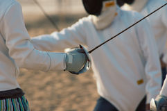 Fencing on the beach. Men fencing on the beach Royalty Free Stock Photography