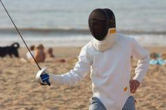 Fencing on the beach. Men fencing on the beach Stock Photo