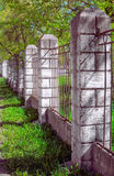 Fencing from concrete columns and a metal lattice. The fence of concrete pillars and metal lattice Royalty Free Stock Photography