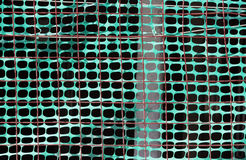 Fencing of construction site with green grid Royalty Free Stock Photography