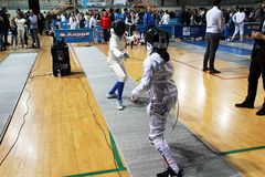 Fencing fight. A young women fencing fight at eboli in italy royalty free stock photos